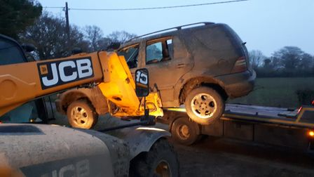 A muddy Mercedes was lifted onto a transporter by JCB after police responded to reports of hare coursing yesterday...