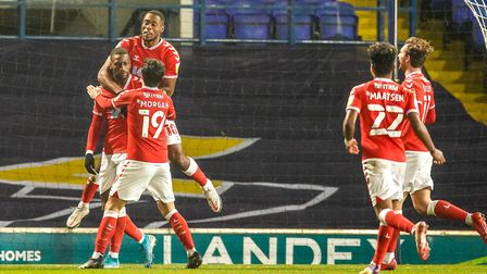Charlton players celebrate with Omar Bogle, after he had scored to give the visitors a two goal advantage. Picture...