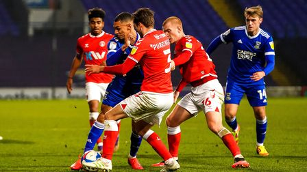Kayden Jackson is outnumbered as he battles for the ball during the Charlton Athletic game.Picture: Steve Waller...