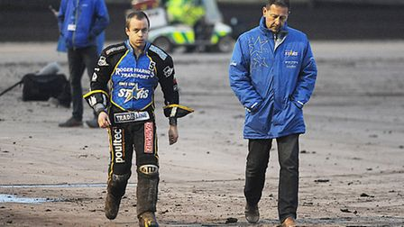 Kenneth Bjerre, left, walking back to the pits after the nasty looking fall in heat three with team
