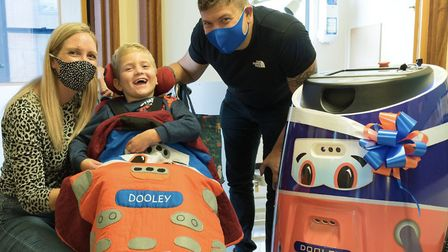From L-R, Becky, Charlie and Wayne Nicholls with Dooley the cleaning robot at Ipswich Hospital, which was named by Charlie...