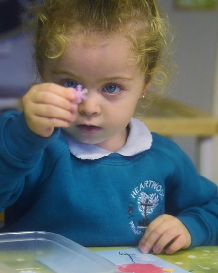 Three-year-old Tiasha-Jean at work at Heartwood Primary and Nursery School at Swaffham working on he