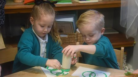 Reception children four-year-olds Ariyah and Riley at Heartwood Primary School at Swaffham working o