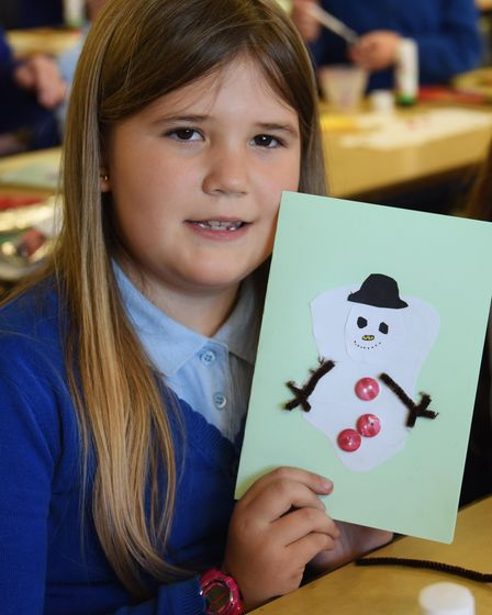 Anna, eight, at St Mary's Junior School at Long Stratton, shows her Christmas card for the EDP proje