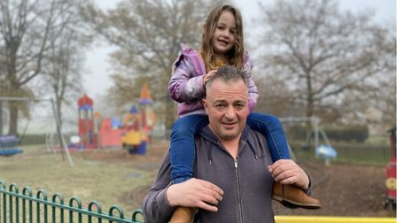 Dean Flack and three-year-old Evie Flack at Castle Park play area.