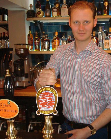 The Fritton Arms pub, Lord Somerleyton's latest venture. Ben Davenport, manager, behind the bar. Pic