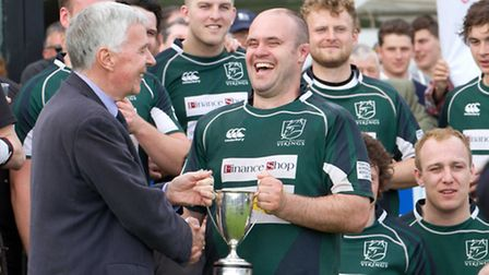 All smiles as North Walsham Rugby Club's Stuart Loose receives the Woodforde's Norfolk Senior Cup fr
