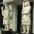 The statues at the entrance to the Samson and Hercules.