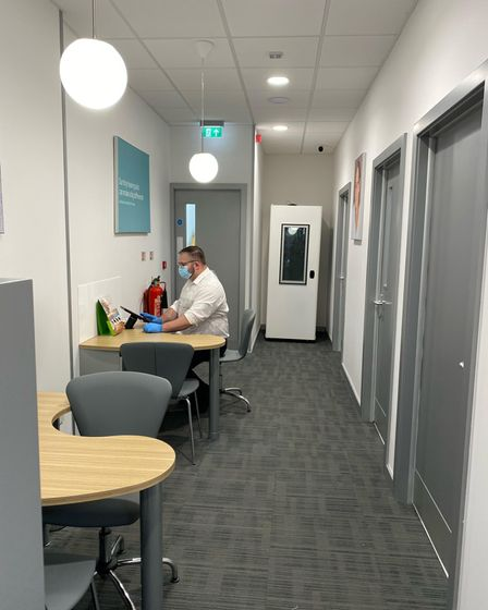 A team member in the new Specsavers Audiologists store on St Stephens Street in Norwich