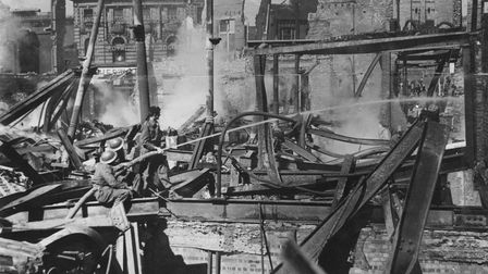 Firefighters tackle the blaze at Curls after the Baedeker raids in 1942
