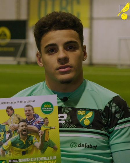 Canaries defender Max Aarons with a copy of the new Norwich City sticker book