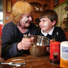 Lindsey Macpherson and her grandson Josh Uglow (9) making cakes for the Worstead Big 100 Cake Sale.P