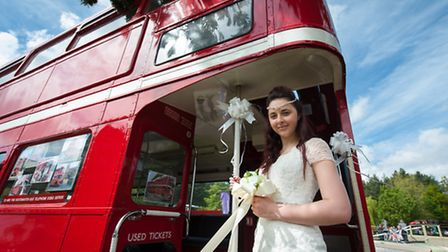 Lucie Baxter models a La Belle Angèle dress aboard an Awayadays Routemaster bus at the EDP wedding s