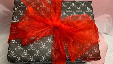 A present box wrapped with a red bow