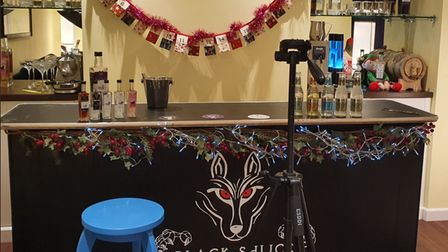 A bar with alcoholic drinks on display