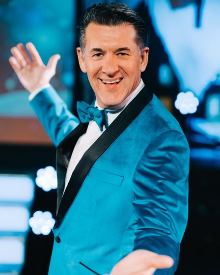 Host, Olly Day,performed in Strictly Christmas