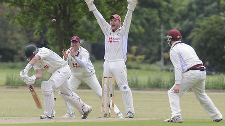 Action from minor counties cricket at Wisbech in June 2013, with Cambridge v Norfolk - Norfolk batsm