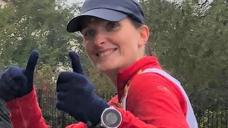 Karen Wells give a 'thumbs up' to supporters as she runs the London Marathon distance. Pictures: Lyn and Cathy Gibb-de Swarte