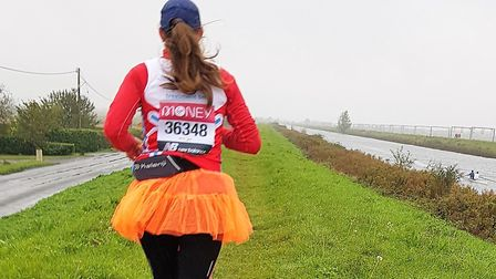 Karen Wells ran along long stretches of riverbank around Littleport as part of the 26.2 mile distance. Pictures: Lyn and...