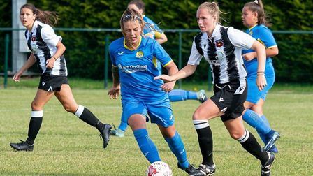 Adele Munday (blue) was named player of the match for March Town Ladies in their league defeat at St Ives Town Ladies...