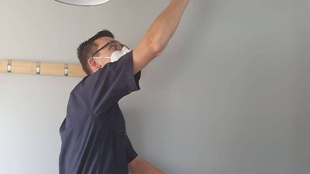 A member of Essex County Fire and Rescue Service's Home Fire Safety team testing a smoke alarm. Picture: Essex County Fire...