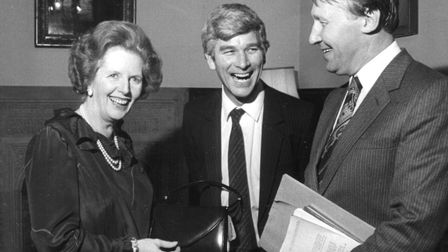 All smiles at Westminster as Margaret Thatcher receives a Norwich-made handbag from Len Fedges. On the right is Norwich...