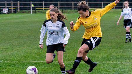 Kara Lumley (right) keeps a Cambridge City Ladies 3rds winger in check for March Town Ladies. Picture: STEVE HONE