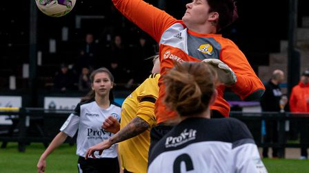 March Town Ladies goalkeeper Tori Sharpe punches clear against Cambridge City Ladies 3rds. Picture: STEVE HONE