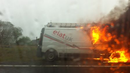 Van on fire on the A11 near Red Lodge
