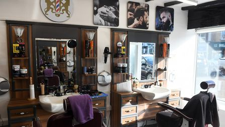 Salih Solak, manager of Kings Barbers and Ugur Bozkurt are bidding for success since opening the business in July. Here...