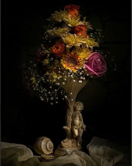 Ely Photographic Club held its first photographic competition via Zoom. 2nd: Cherub and Flowers by Sharon Powell