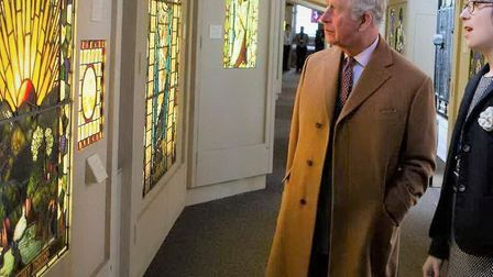 HRH The Prince of Wales discusses a window in the collection with the museum's curator Dr Jasmine Allen during a visit in...