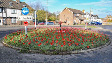 This stunning Remembrance Day poppy display appeared on a roundabout in Sutton overnight. Picture: Simon Pearce