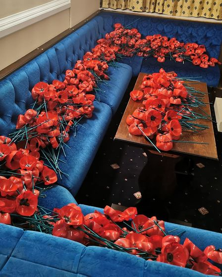 Creating the stunning Sutton remembrance display. Picture: Supplied