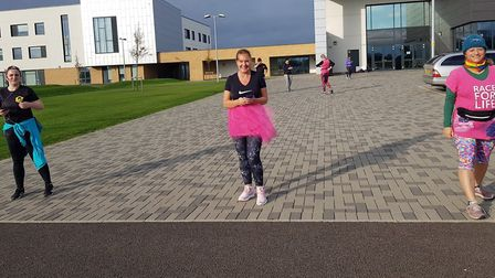 Littleport runners took part in a socially distanced 5k fundraiser to raise funds for Breast Cancer Awareness, with some...
