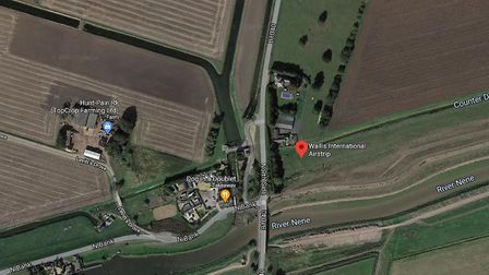 Wallis International Airfield, located on the north bank of the River Nene, where a light aircraft landed badly. An...