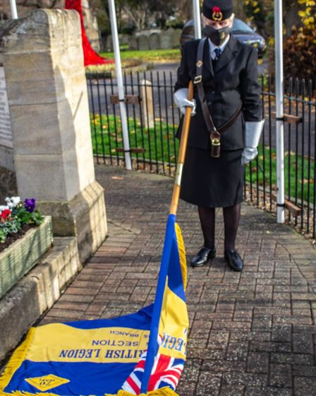 Pebbles decorated with poppies and wreaths were laid at the Parish Church of St Peter & St Paul in Chatteris as the town...