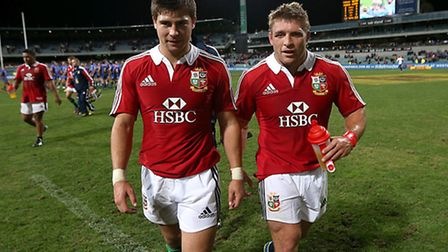 British and Irish Lions' Tom Youngs (right) and Ben Youngs leave the pitch after the final whistle d