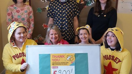 The nursery staff in their pyjamas for our fundraising week with the total amount raised.
