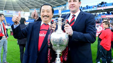 Cardiff City chairman Vincent Tan (left) and manager Malky Mackay with the Championship trophy. Pict
