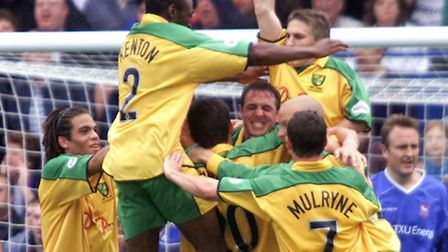 Norwich City's Malky Mackay (centre) is mobbed by his team-mates after opening the scoring against I