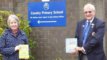 Derek Rutter (right), president of March Lions, presented the journals to Fiona McCallum, headteacher at Cavalry Primary...