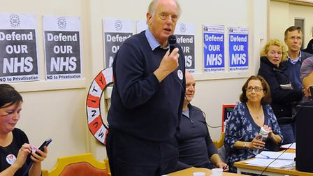 Ian Gibson speaks in the crowded room at the Vauxhall Centre as the campaign to save mental health s