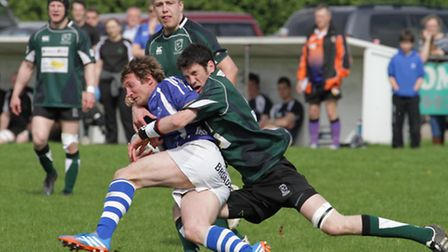 Action from the Woodforde's Norfolk Senior Cup final between North Walsham and Diss at Scottow. Pict