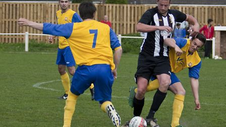 Action from the Hospital Cup final between Swaffham Town and Castle Acre Swifts at Shoemakers Lane -