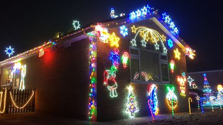 A Littleport home has been covered in Christmas lights in a bid to raise funds for the Teenage Cancer Trust and paint...
