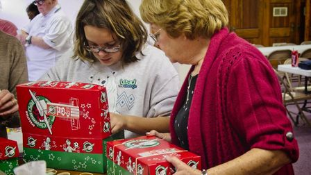 Ely Foodbank has teamed up with Cambridge Commodities in a bid to stock 100 shoeboxes for those in need this Christmas.