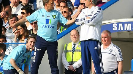 Norwich City first team coach Mark Robson has a word with Chelsea boss jose Mourinho at Stamford Bri