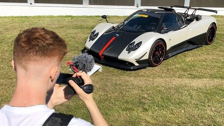 Supecar spotter Josh Scoot filming at an event. Picture: ScootSupercars