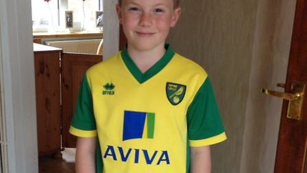 Alex Johnson, 9, from Attleborough, will lead out Norwich City against Arsenal in their last match o